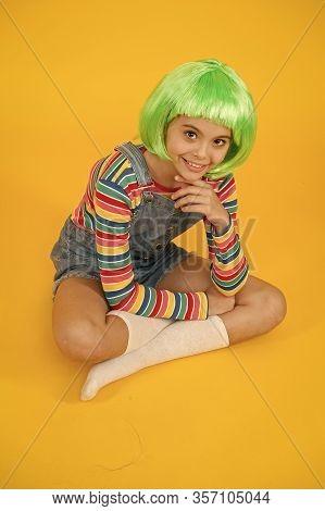 Create New Look In Salon. Happy Girl With Beauty Look. Little Child Wear Green Hair Wig In Fancy Sty