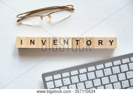 Modern Business Buzzword - Inventory. Top View On The Board Keyboard Glasses With Wooden Blocks. Clo