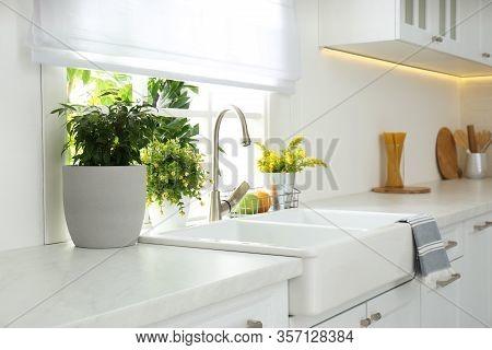 Beautiful White Sink Near Window In Modern Kitchen