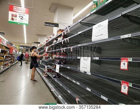 Gold Coast, Australia - March 21, 2020: Woolworths Supermarket Empty Pasta And Sauce Shelves Amid Co