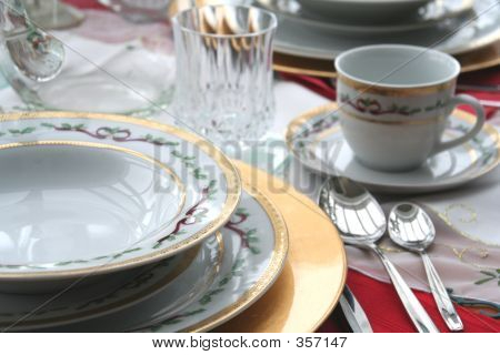 Porcelain Dish Set At The Dinner Table