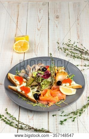 Appetizer With Smoked Salmon, Butterfish And Herring, Wheat Croutons With Cream Cheese, Mix Salad Wi