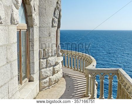 Balcony And Sea Views. Swallows Nest-gothic Castle Over The Cliff Of The Sea, The Emblem Of The Sout