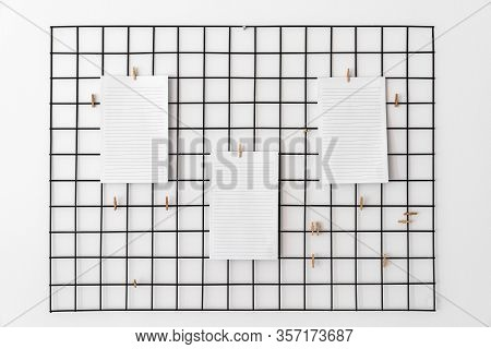 Blank Paper Attached With Pegs On Grid As Notice, Reminder Or Planing Board For Succesfully Followin