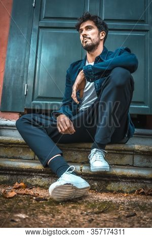 A Young Entrepreneurial Businessman Sitting On The Ground In An Autumn Session