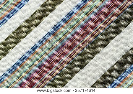 Background From Vintage Natural Linen Fabric. Flax Texture. Striped Colorful Linen Fabric. Canvas Te