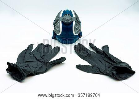Horizontal View Of Black Nitrite Gloves And Coronavirus Mask, Isolated On A White Background. Virus