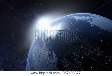 View Of Planet Earth From Space During A Sunrise. Europe At Night Viewed From Space At Night With Ci