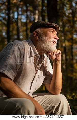 Live Your Life And Forget Your Age. Aged Man Relax In Nature. Aged Person With Grey Beard Hair. Aged