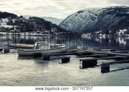 Boat near pier in Hardangerfjord in Norway
