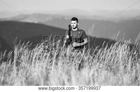 Hunter Spend Leisure Hunting. Walking In Mountains. Hunting Masculine Hobby Concept. Man Brutal Game