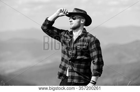 Far Away. Cowboy In Hat Outdoor. Countryside Concept. Farmer On Rancho. Man On Mountain Landscape. C