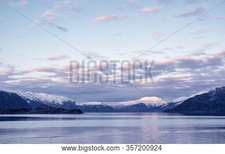 Sunset over Hardangerfjord in Norway.