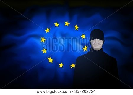 Covid-19 Coronavirus Epidemic In The European Union. Man In Medical Mask On Background Abstract Flag