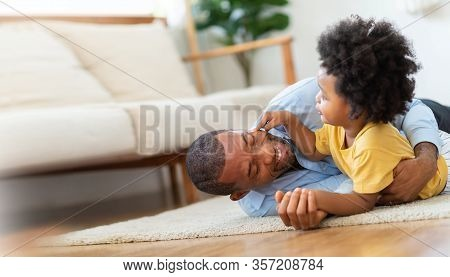 Happy African Father And Little Child Son Spending Time Playing At Home Together. Smiling Dad In Blu