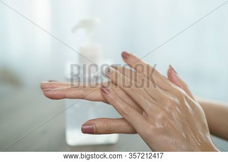 Female Hands Using Wash Hand Sanitizer Gel Pump Dispenser. Clear Sanitizer In Pump Bottle, For Killi