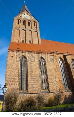 Brick Church In Northern Germany. View Of Church Steeple. Typical Construction Of The Baltic Coast.