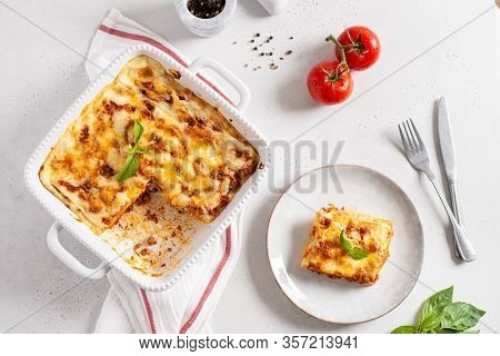 Tasty Lasagna With Meat And Cheese On A Plate, Top View. Traditional Italian Lasagna With Vegetables