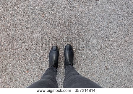 Black Shoes Standing On The Asphalt Concrete Floor. Feet Shoes Walking In Outdoor. Youth Selphie Mod