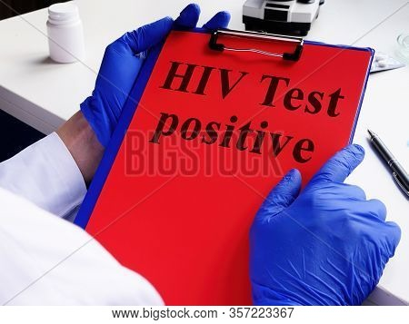 Doctor Holds Hiv Test Positive And Clipboard. Hiv/aids Concept.