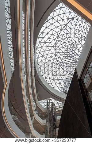 Shanghai, China - November 10, 2018. Panoramic Lifts In The Atrium Of A New Shopping Mall Luone.