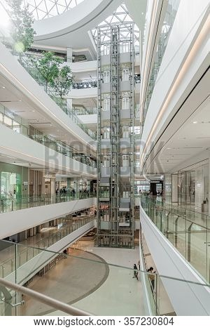 Shanghai, China - November 10, 2018. Panoramic Lifts In The Atrium Of A New Shopping Mall Luone Shan