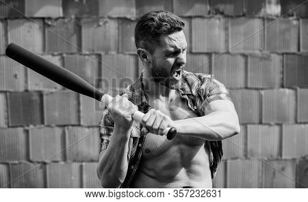 Feel My Strength. Man Unshaven Face Muscular Torso Hold Black Baseball Bat. Strong Temper. Confident