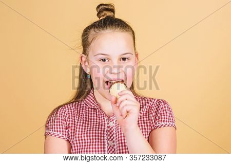 The Freshest Ice Cream On Earth. Cute Little Girl Eating Ice Cream. Small Child Licking Ice Cream In