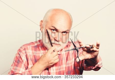 Close Up Of Man Shaving. Shaving Scissors Tool Kit. Cut And Brush Hair. Mature Bearded Man Isolated