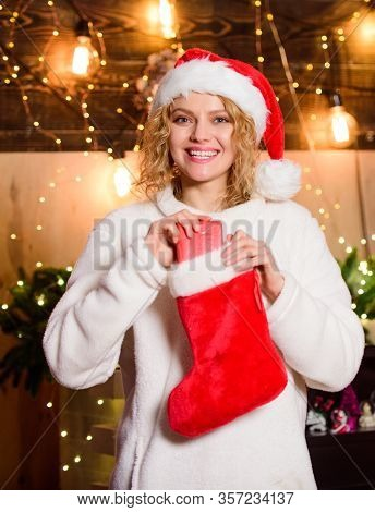 Buy Or Knit Your Christmas Stocking And Stuff Them With Special Goodies. Woman Hold Red Stocking. Ne