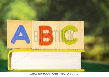 The Letters Of The English Alphabet Abc On The Book. Learn Foreign Languages. English For Beginners