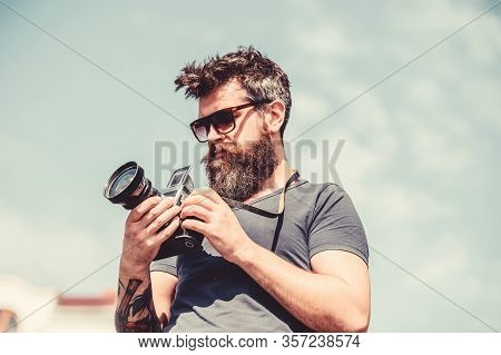 Content Creator. Man Bearded Hipster Photographer. Man Shooting Photos. Old But Still Good. Manual S