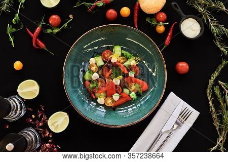 Appetizing Food Laid Out On A Black Background. Food Photography For Restaurant Menu