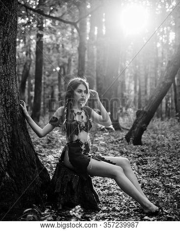 Female Spirit Mythology. She Belongs Tribe Warrior Women. Wild Attractive Woman In Forest. Folklore