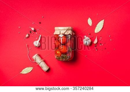 Pickled Tomatoes In Jar On Blue Background. Top View. Flat Lay. Copy Space. Canned And Preserved Veg