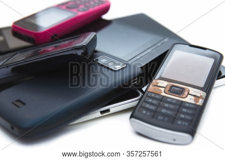 A Bunch Of Old Useless, Non Working, Dirty, Dusty And Rusty Cell Phones. Unreasonable Consumption An