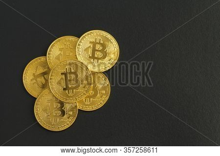 Bitcoin. Crypto Currency Gold Btc. Coins On A Black Background.