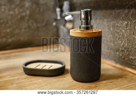 Liquid Soap Dispenser And Soap Dish On A Wooden Shelf. Close-up