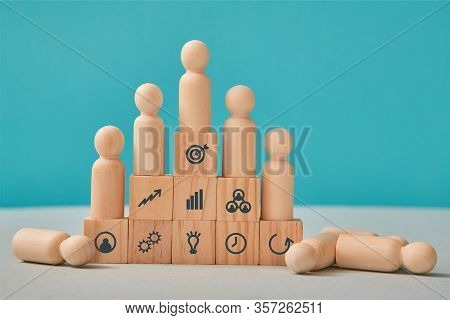 Hierarchical System. Leadership And Teamwork. Command Chain. Team Competition. Wooden People On Pyra