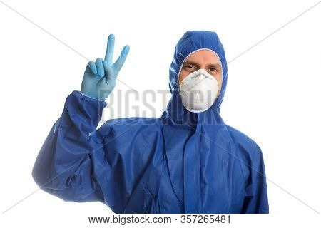 Doctor In Protective Clothing Showing V Victory. Everything Will Be O.k.