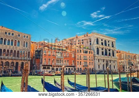Grand Canal Waterway In Venice With Docked, Moored And Sailing Gondolas Boats, Palazzo Cavalli Palac