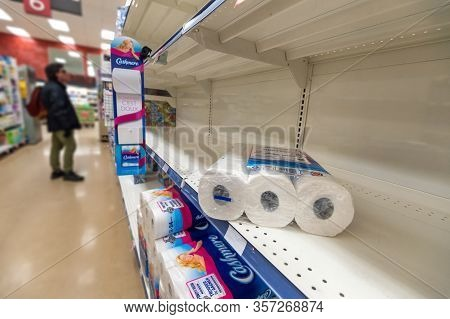 Montreal, Ca - 20 March 2020: Empty Shelves Of Toilet Paper In A Supermarket. Shortage Of Supplies D