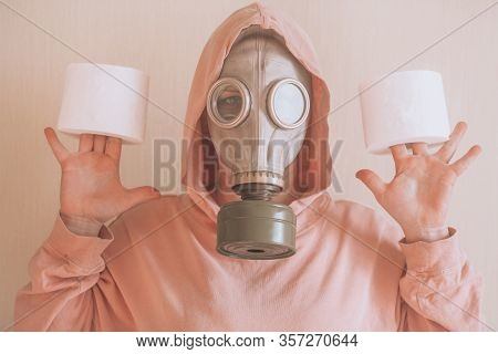 Woman In A Gas Mask With Toilet Paper In Her Hands. Conceptual Portrait Of A Girl, News On The Topic