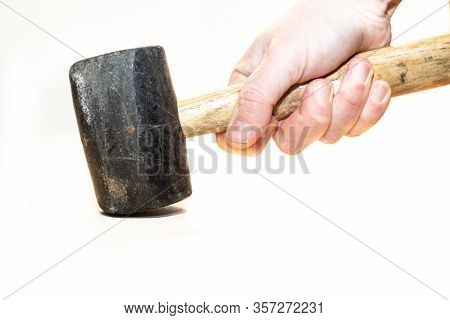 Rubber Mallet. Hand Holding A Rubber Mallet