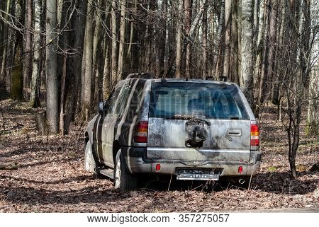 Moscow, Russia - 21.03.2020: Abandoned Car In The Forest. Criminals Stoled The Car And Abandoned In