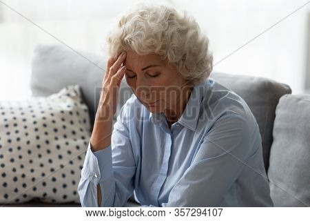 Sick Senior Woman Touch Head Suffering From Dizziness At Home