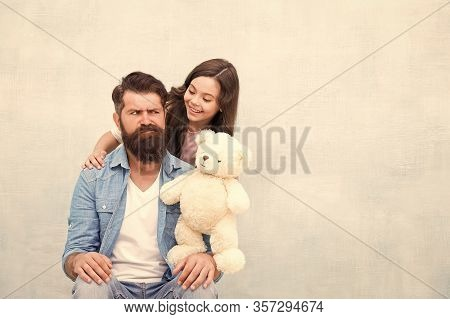 Lets Play Together. Little Child Play With Bearded Man. Small Daughter And Father Play With Soft Toy