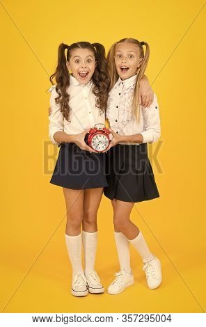 Getting Back To Class In Time. Happy Little Girls Back To School On September 1. Small Schoolchildre