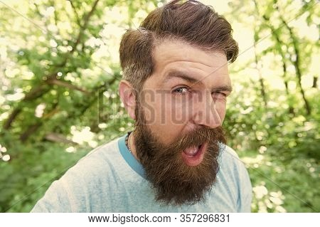 The Mustache Made Me Do It. Bearded Man Winking With Stylish Mustache Shape. Brutal Hipster With Tex