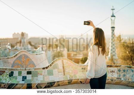 Female Travel Photographer/videographer And Bloger Using Advanced New Phone Camera With Internal Sta